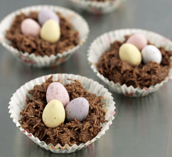 Chocolate shredded wheat nest with mini eggs in the middle
